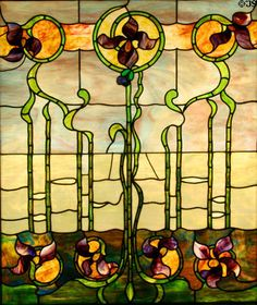 Stained glass window (c 1900) with Art Nouveau Irises at Stained Glass Museum. Chicago, IL.