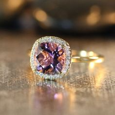 Purple Amethyst Engagement Ring in 14k Yellow Gold Halo Diamond Ring 8x8mm Cushion Gemstone Amethyst Ring (Custom Made Ring ok) on Etsy, $548.00.....yes please.
