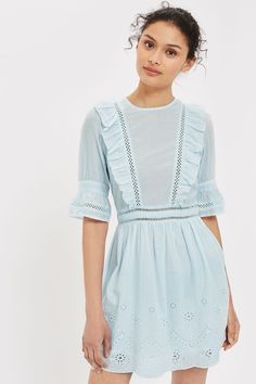 Tap into a girly look for ss17 with our broderie mini dress in blue. Adorned with ruffles to the bodice, it also features fluted quarter length sleeves. Finished with a dainty tie detail to the back.