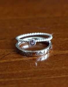 """Personalize this """"I love you to the moon and back"""" ring with the birthstone of your choice. This sweet but sentimental ring set is a perfect gift for a daughter, girlfriend, significant other or mom layered with the birthstones of those most important. - Sterling silver """"I love you to the moon & back"""" ring is rhodium plated in a high polish. - Stackable Birthstone Rings are 2mm wide and available in each month. - Set is available in sizes: 5, 6, 7, 8, 9. Add more birthstone rings by…"""