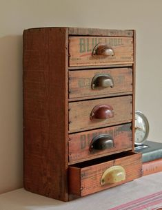 Repurposed vintage cheese boxes made into a cute little organizer.