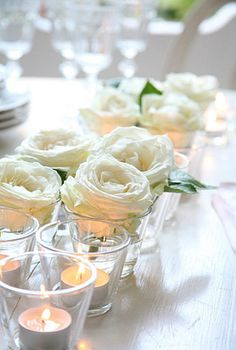 White roses & votives...simple table centerpiece elegance