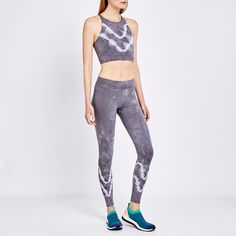 This high-neck crop-top-meets-sports-bra in a monochrome, tie-dye gradient print pairs well with solid black or heather-grey leggings for a comfortable,...