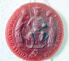 "The 'Charlemagne Prize' and the Legacy of the 'Pater Europae':  (Pictured: Seal of the city Aachen by 1327: Inscription in Latin: ""P. REGALIS SEDIS URBIS AQUENSIS"". Picture of the seal: Charlemagne between two Saints, at his feet a shield with Eagle.)"