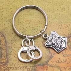Police Badge and Handcuff silvertone key chain Handcuff Jewelry, Handcuff Key, Badge, Jewelry Sets, Police Wife, Personalized Items, Key Chain, Leo, Jewerly