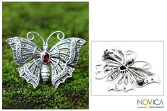 Ornate motifs cover the gossamer wings of a butterfly brooch. Beautifully depicted in sterling silver, the elegant creature is centered by an oval garnet as Putu Putri presents an enchanting brooch that can also be worn as a pendant.
