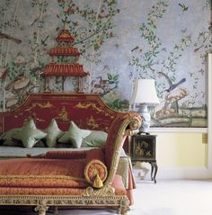 Chinoiserie describes a European fantasy vision of China. Prince Regent Suite at Brocket Hall England, commissioned by the Prince himself, for his mistress Maria Fitzherbert in 18th Century. The stunning hand painted Chinese wallpaper is still in place.  Other features of Chinoiserie is the porcelain lamp, black lacquered side table and the red headboard of magnificent golden pagodas and dragons.