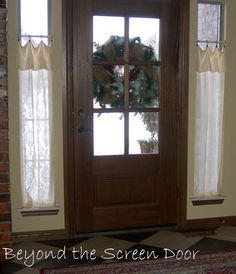 Solution for the windows beside the front door...Love the casual, welcoming effect by folding the curtain!
