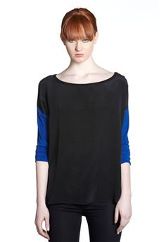 Bailey 44 Bot Contrast Sleeve Top is an urban chic color block look that works back to everything in your closet, it can be casual or dressed up.