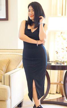 Sizzling @candgrace in her striking black sleeveless midi dress. #LBSDaily