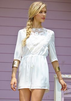 White open-back lace romper with crochet and lace detailing at the front and comes with elbow-length sleeves and a drawstring waistline. | Lookbook Store Jumpsuits and Rompers