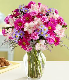 Shower someone special with 75 fresh blooms, straight from your favorite garden. Soft hues of daisy poms mixed with mini carnations, asters and alstroemeria make the perfect bouquet.