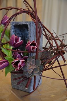 Tulips, succulents, and red dogwood floral design