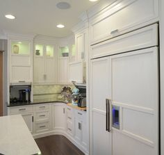 Kitchen cabinets with appliance garages.