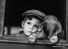 Boy and baby elephant.   Mom, he followed me home, can I keep him?