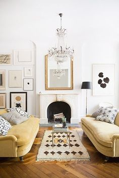 mustard couches with chandelier
