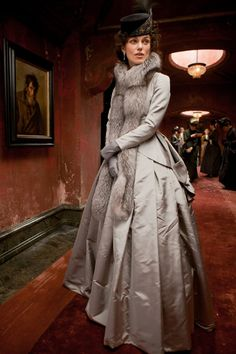 Keira Knightley costume in 'Anna Karenina', 2012. Costumes designed by Academy Award winner Jacqueline Durran. All millinery is designed and made by Sean Barrett. The elegant, silver-gray jacket and skirt with long silver fox stole and gray gloves is worn during one of Anna's outings with Count Vronsky.
