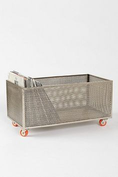 Perforated metal rolling storage bin. I'd love to put a reclaimed wood top on this and have it be a closed storage bin.
