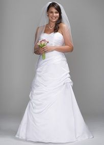 This beautiful satin bridal gown is draped and pleated to create a stunning sculptural look.   The flattering shape is enhanced by a  pleated surplice sweetheart neckline and slight dropped waist.  Side draped skirt features pick-up details on front and back, with beaded floral embellishment at waist.  Floor length (no train). Available in White or Ivory. Fully lined. Back zip. Dry clean.  To preserve your wedding dreams, try our Wedding Gown Preservation Kit.