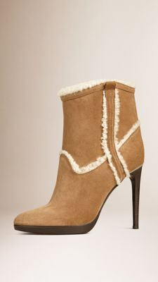Burberry-Cute! https://us.burberry.com/shearling-lined-suede-ankle-boots-p39919271