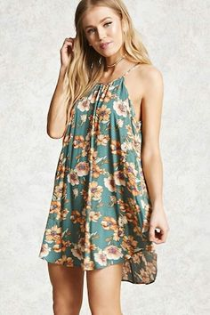 Style Deals - A crinkled woven cami dress featuring a floral print, a round neckline, buttoned keyhole back, and a swing silhouette.