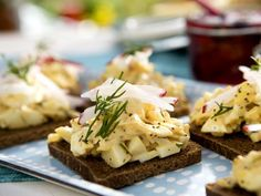 Open-Faced Egg Salad Tea Sandwiches with Crab and Poppy Seeds on Pumpernickel