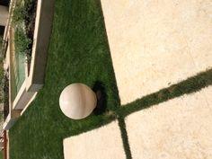 Sphere in travertine stone, omnidirectional sound module designed by Lorenzo Brusci/Architettura Sonora