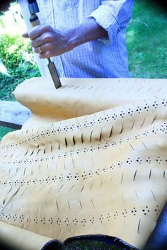 Leather doublet; pinking and slashing