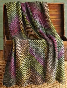 Knitting Pattern for Bias Stripe Afghan - This stunning throw is knit in strips with contrasting diagonal stripes and multi-color yarn and then seamed. Designed by Karen King Garlinghouse for Noro.