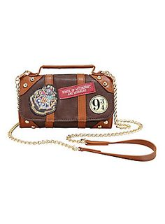 """Pack your bags and get ready to board the Hogwarts Express at Platfrom 9 3/4. This crossbody wallet is the perfect place to store your galleons, sickles, and knuts. Features gold tone hardware, a Platform 9 3/4"""" patch and the Hogwarts crest patch. Flap closure compartment on front. Flap closure wallet on back with 10 card slots and a clear ID display."""