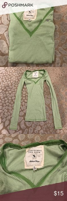 Abercrombie & Fitch long sleeve t-shirt Worn but in good condition. Abercrombie & Fitch long sleeve T-shirt in size XS. Green and white stripes Tops Tees - Long Sleeve