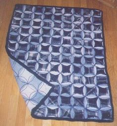 Another recycled jeans circle quilt. I Love it. I'm going to try one with flannel, fleece and old sweat shirts for centers. Extra warm.