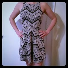 NEW Mini Dress This is a fantastic dress! And it has a cut out in the back to show a little extra. Perfect for summer! Dresses Mini