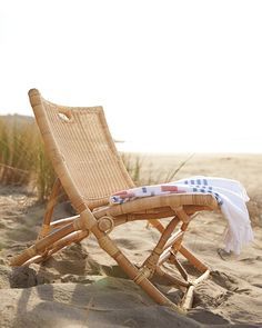 A fold-up frame, a comfy seat, built-in carrying handles – everything about this chair will prove to be indispensable. Designed to perch just above the ground, it's made of natural woven rattan over a bent rattan frame.