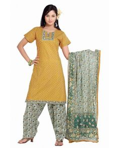 Look ethnic and lively in this printed cotton casual salwar kameez set. The patch work done on Neck will make you trendy and fashionable whi...
