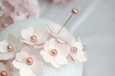 Cute, and so easy to make. Just take card stock, pins, and a flower punch. Pin tiny flowers to your 4 inch Styrofoam ball and you have a perfect decoration for a wedding or any kind of shower (baby, bridal, engagement)!