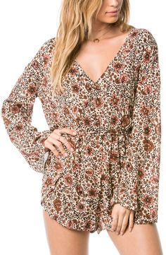 Adoring this vintage-inspired floral print! The flowy bell sleeves add even more interest to this comfy romper.