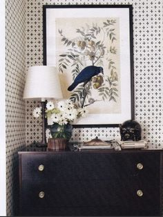Sometimes just a black frame with a white matting can make any picture work in a black and white room