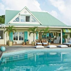 This St. Barts pool fits in perfectly with the home's blue-and-green color scheme, thanks to its vibrant turquoise hue | Coastalliving.com