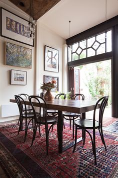 Are filled room, French and vintage rugs, kitchen in an old hotel