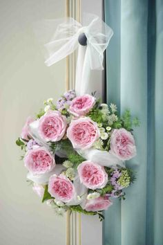 This Miranda #rosewreath is the perfect way to welcome in guests as they enter into your #weddingceremony. The light tea scent and rose pink color are aesthetically pleasing and will uplift the mood of the day even higher!