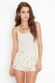 cream high-waist tap shorts featuring a colorful confetti sequin and beaded detailing