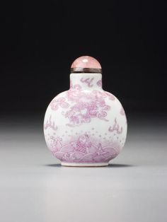 A puce-enamel porcelain 'dragon and carp' snuff bottle Daoguang iron-red seal mark and of the period, Imperial kilns, Jingdezhen, 1821–1850