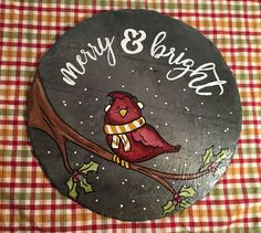 Serve your favorite Christmas dish to family and friends on this adorable slate trivet. It measures approximately 13 in circumference and serves as a creative conduit for hot plates coming from oven to table. Because of slates durability it works as the perfect trivet! Plus, while its not being used, it serves as an adorable addition to your kitchen décor! Each slate is backed with a liner of cork to protect your table, while the design is sprayed with a sealant to protect the painting as…