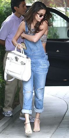Obsessed or Hot Mess? Vote on These Daring Looks | OVERALLS WITH CROP TOPS | Have you been spending all your time at the gym doing side sit-ups, but not crunches? If so, has Selena Gomez (in a Black Orchid denim onesie) got an outfit for you!