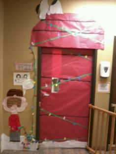 Like the idea for snoopy birthday front door.     Classroom door decorated for Christmas