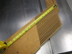 "Use hardwood with fairly straight grain. Lay a board on the machine you want to use the feather board on. You may want something roughly 20"" long, 8"" wide for a table saw top. Position it so you can get two clamps on it. To get the angle, draw a line parallel with the fence. Teeth about 1/8"" wide with a saw kerf, about 1/8"" between. This makes for flexible teeth that will deal with slight variations in the width of your work pieces."