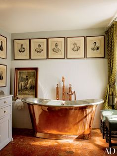 Engravings of the Bonaparte family decorate an Empire-theme guest bath in French filmmaker Jean-Louis Remilleux's Burgundy château.