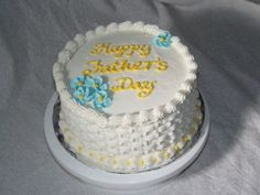 DSC06838.JPG+-+This+is+my+first+basketweave+cake+that+I+made+for+my+father.++I+used+a+buttercream+frosting+with+royal+icing+flowers.++I+used+white+so+that+my+mistakes+wouldn't+be+so+noticeable...maybe+next+time+I+will+be+brave+and+use+some+color!
