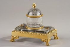 A gilt bronze and crystal inkwell